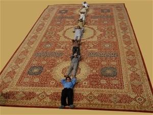 Afghan carpet makers enjoying their time at Domotex 2010.