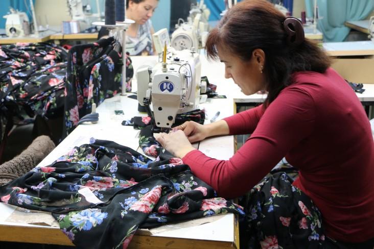 Female worker sews garment at Portavita clothing factory