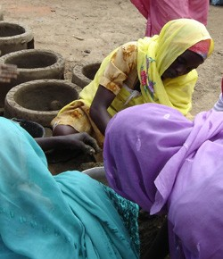 Women make fuel-efficient stoves in Mukjar camp in West Darfur.