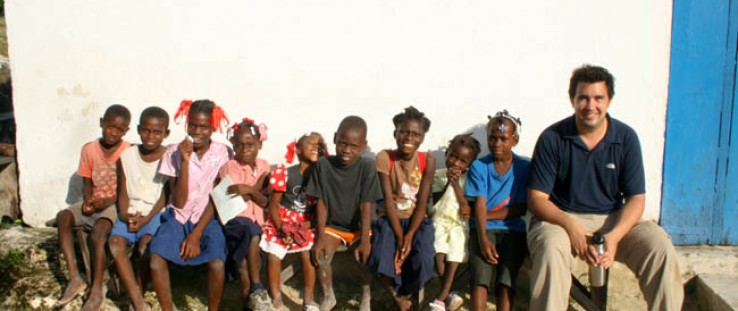 USAID's Lee Cohen with students of the Morency Primary School near Les Cayes, Haiti