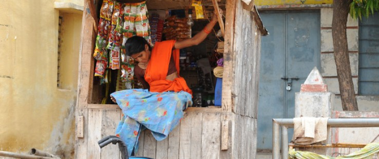 Lalithamma's new wheelchair allows her greater independence, including moving about to buy materials for her shop.