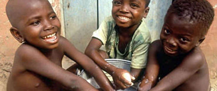 Children wash their hands in Ghana, where USAID supports prevention and treatment of trachoma, a blinding eye disease.