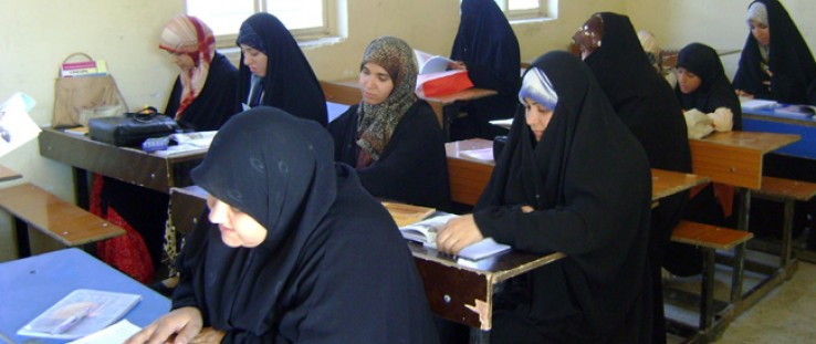 Iraqi women learn how to read and write in USAID's Women's Awareness and Inclusion Center in Basrah.