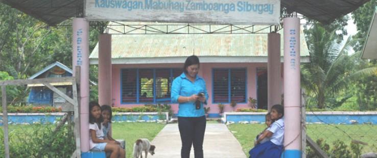 Lolita Singahan outside her school.