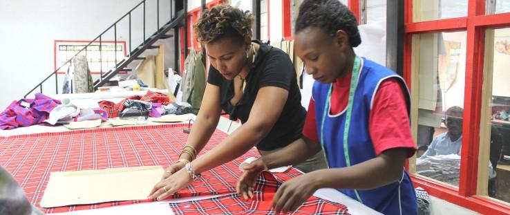 Masai fabrics are hand cut in preparation for custom-made Doreen Mashika handbags.