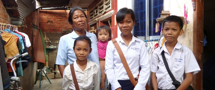 Miean Keng and her grandchildren, ready for school