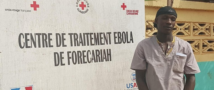 Alseny Touré works at the French Red Cross site near the Ebola Treatment Unit in Forécariah, Guinea.