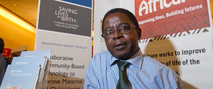 Christopher Mfornyam, of Africare, mans his organization's display at USAID's third Saving Lives at Birth event.