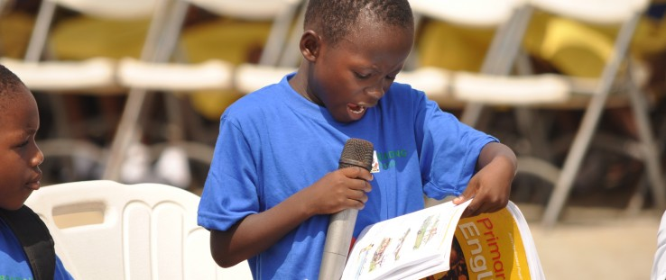 A child reads to the audience during Ghana's reading festival in Cape Coast.