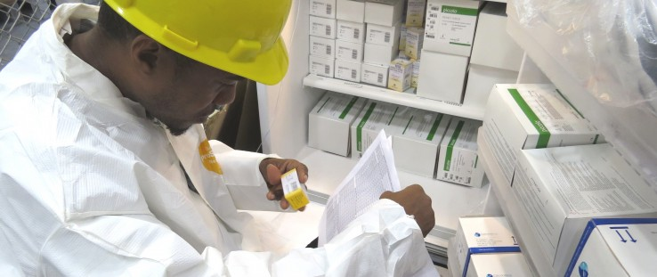 A warehouse staffer checks new stock of life-saving drugs for Guyana's HIV/AIDS population.
