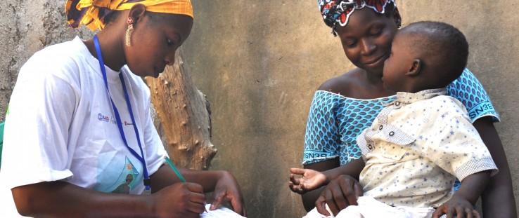 Djenebou Keita, a community health worker, tests a 2-year-old boy for malaria in Mali.