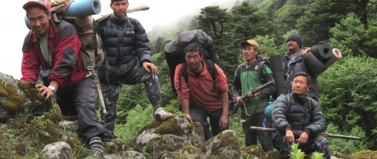 A community anti-poaching patrol in eastern Nepal removes snares and deters hunting and other illegal activities.