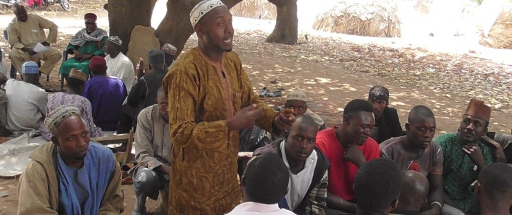 Osaka Sansui, a farmer living in the Ardor Siding community in central Nasarawa state, speaks at a USAID-conducted peace dialogue.