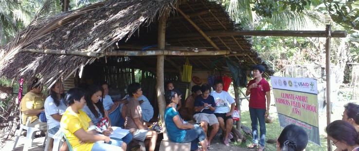 Farmers write notes during a Climate Field School session in barangay Dela Fe in Buhi, Camarines Sur.