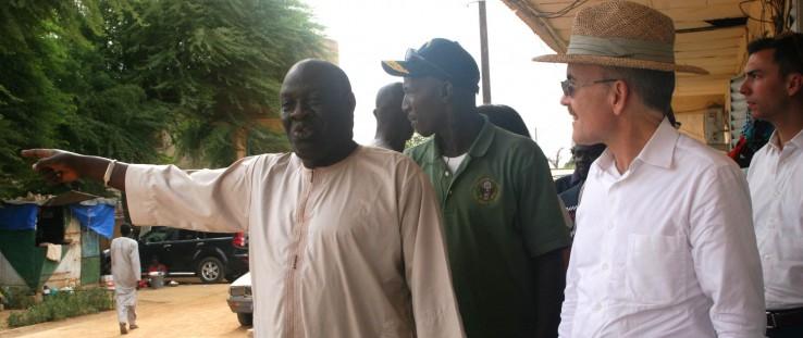 Amadou Bakhao Diaw, left, welcomes U.S. Ambassador to Senegal James P. Zumwalt to the Department of Dagana Hospital.
