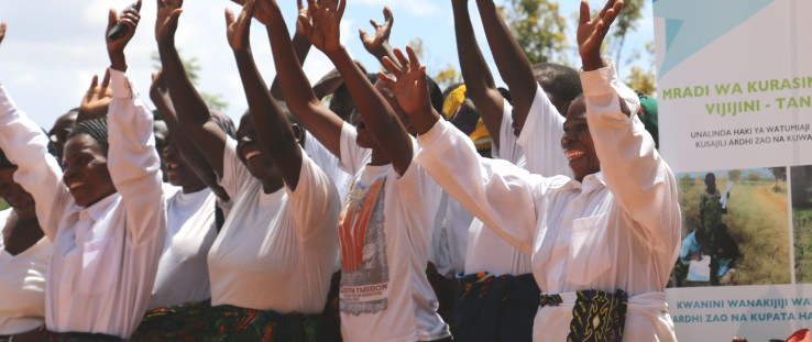 Villagers in Kinywang'anga celebrate the completion of land registration efforts in their community.