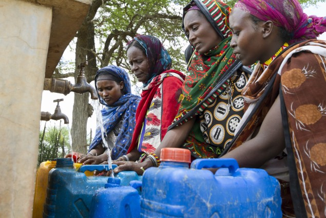 Women fill their jerry cans at a water point rehabilitated by USAID. For most rural areas of Ethiopia, water points are the main source of water for households.