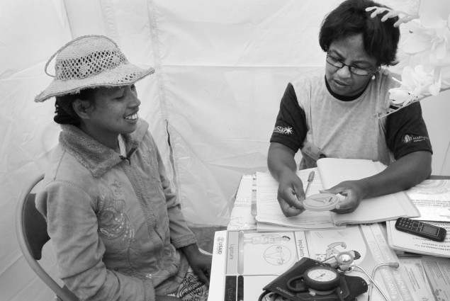 CHW explains Family Planning methods to a client