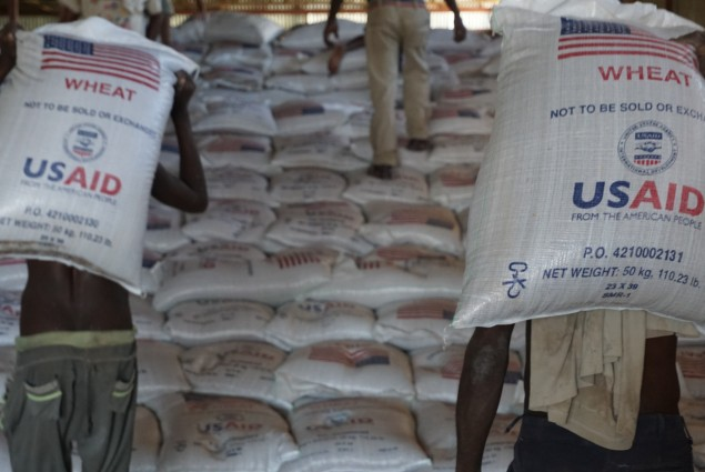Workers stack sacks of wheat in a USAID warehouse in Dire Dawa, one of four primary distribution points in Ethiopia. USAID provides the food through its Joint Emergency Operation managed by Catholic Relief Services.