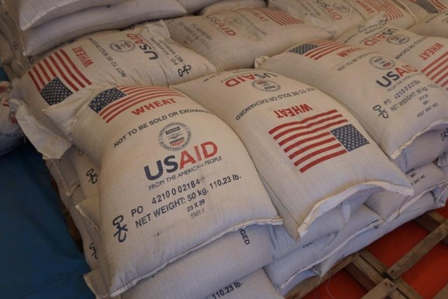 Fifty kilogram bags of wheat provided through the assistance of the American people are stored inside prior to distribution.