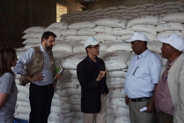 Representatives of USAID partner Relief Society of Tigray (right), describe the food distribution system in Hawzien to USAID Office of Foreign Disaster Assistance Director Jeremy Konydnyk (left) and U.S. Chargé d'Affaires to Ethiopia Peter Vrooman.