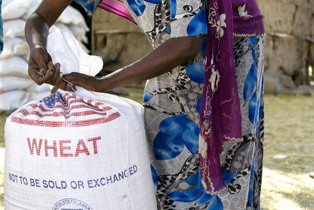 Wheat provided by the American people will help this woman's family during these lean times.