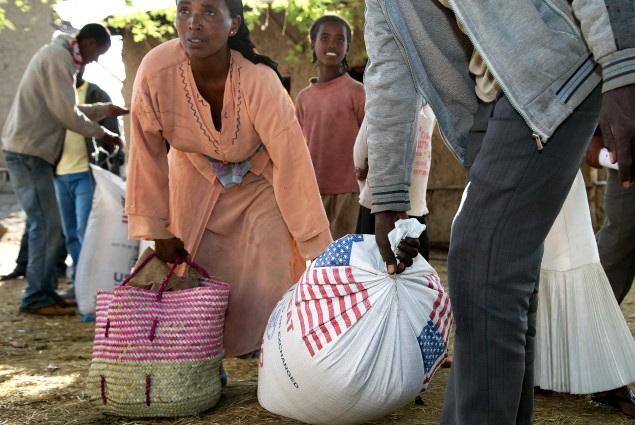 A couple start off for home with their family's rations.