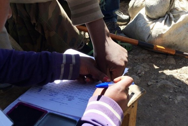 To ensure that each household gets its proper allotment, recipients sign for their emergency food rations with thumb prints.