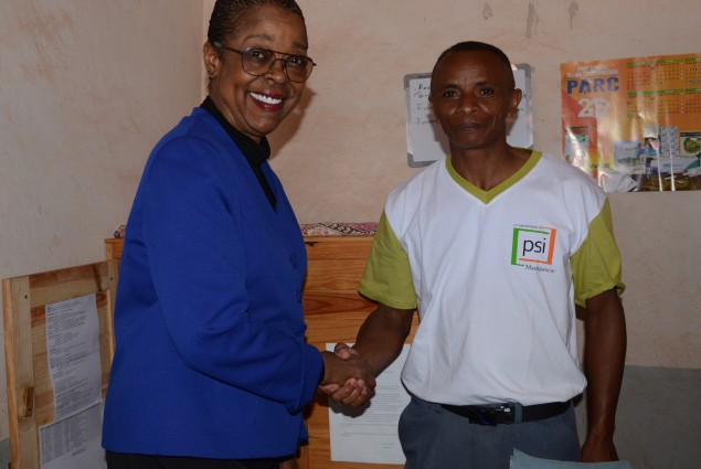 Shaking hands with a Community Health Volunteer