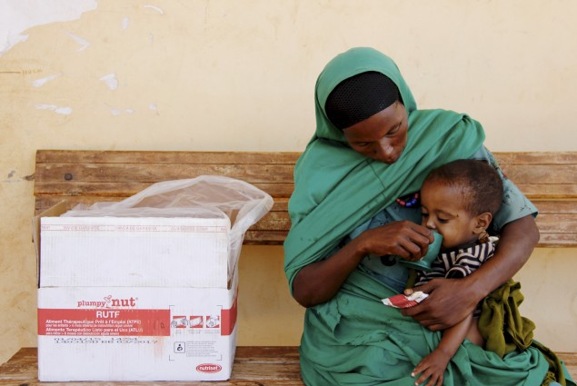 Two-year-old Seid eats high nutrient peanut paste provided by a health extension worker.  Yesriba, 28, with her son Seid, who is recovering from severe-acute malnutrition, in Sewena, Bale Zone. Weak from poor nutrition, the child was diagnosed and treated for pneumonia.