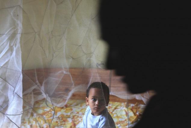 child under a bednet in Ranomafana