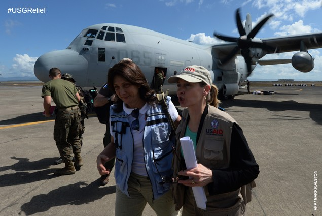 Luiza Carvalho (L) of the United Nations and Assistant Administrator of USAID Nancy Lindborg (R) arrives to inspect their relief