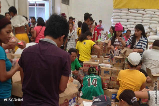 Warehouse at Tacloban Task Force Logistics headquarters where volunteers sort and emergency supplies provided by USAID and other