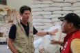 DAA Greg Beck discussing continuous relief operations with a DSWD rep
