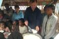 Ambassador Lane participates in a WFP school canteen while FFP Dina Esposito looks on
