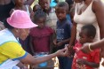 CHV administering drug to a child