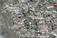 This aerial photo shows flattened houses in the city of Tacloban, Leyte province, in the central Philippines on November 11, 201