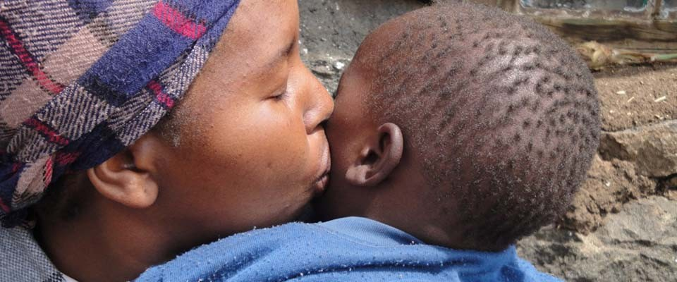 Mother Kisses Son