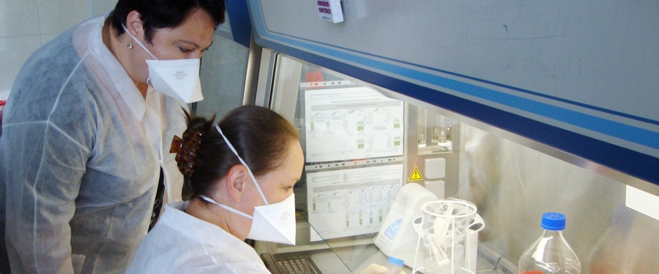 Head of MOH Central Reference Laboratory Anna Barbova supervises a laboratory specialist, who conducts smear microscopy testing.