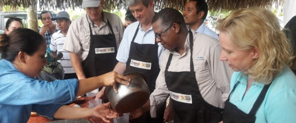 USAID Acting Administrator Wade Warren ready to taste chocolate made with fine flavored cacao