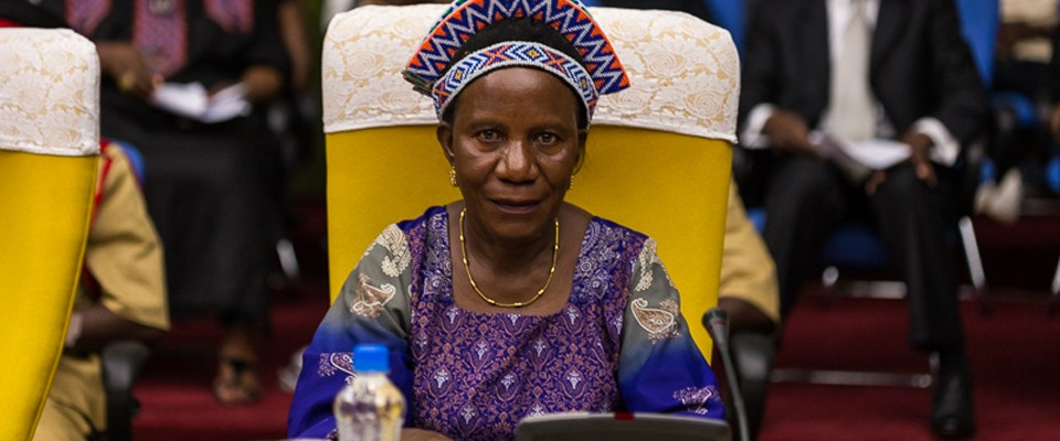 A photo is displayed of a Zambian chieftainess who attended the first-ever forum for women traditional leaders.