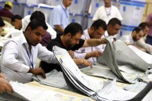 Iraqis count votes at the Independent High Electoral Commission headquarters in Baghdad on March 12, 2010.