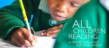 A boy practices reading and writing.