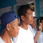 "Nasirin ""Kah Nas"" Taraji (middle) stands guard with other members of the Kulape/Batu-Batu marine sanctuary enforcement team."
