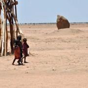 Ethiopian pastoralist children walk in the arid lands of Dire Dawa.