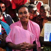 Three young women in Wendo Genet proudly display their land certificates.