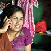 A small entrepreneur uses her mobile banking services to pay for her supplies.