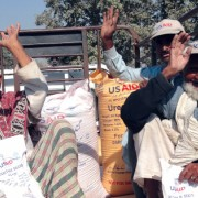 Punjabi farmers return home after receiving 50-kilogram sacks of wheat seed, fertilizer, and vegetable seed as part of USAID's $