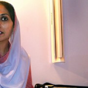 Nazia Bibi displays USAID-supplied equipment to community midwives in Pakistan at a midwife graduation event.