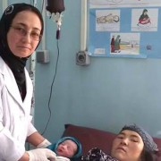 Midwife Friba Hashimi attends to a patient.
